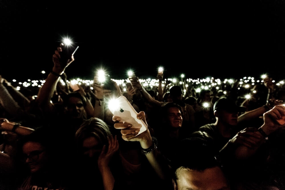 Crowd of people with phones
