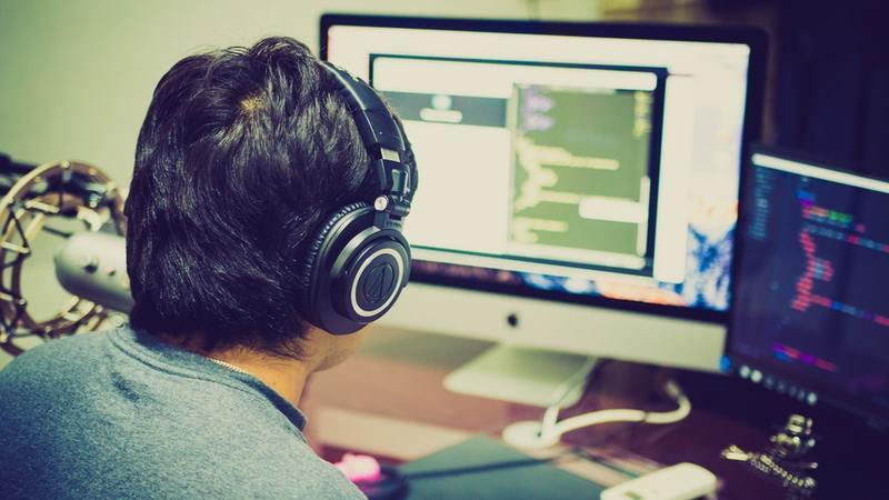 Blockchain programmer working on computer