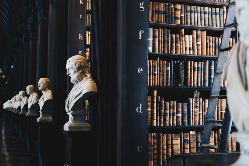 Law library with many books that represent smart contracts